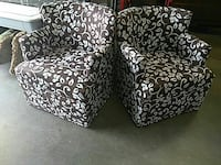 two black-and-white floral sofa chairs