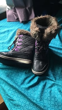 Pair of black-and-brown fur-line boots
