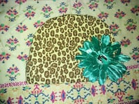 brown leopard knit cap with green flower accent