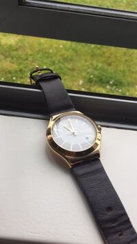 round gold-colored analog watch with black leather strap Rotoorangi, 3879