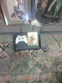 black Xbox One console with controller and game cases Lebanon, 97355