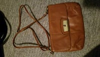 Coach tan or black leather crossbody
