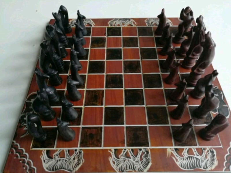 Black and Brown Chess Board 629b514f-e20f-4bff-934d-30784abe56a0