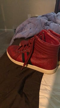 pair of red Adidas high-top sneakers Palm Bay, 32905