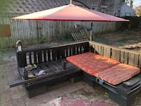 brown and red wooden bed frame 25 mi