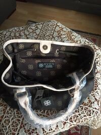 black and white Louis Vuitton leather tote bag