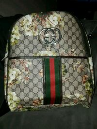 brown and green Gucci backpack Broken Arrow
