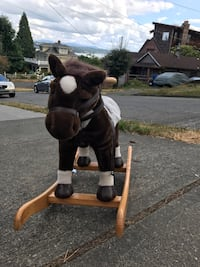 Brown, black, and white ride on rocking horse toy Seattle