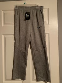 New with tags boys Nike pants size large  Kingsport, 37665