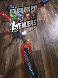 red blue and black avengers bicycle