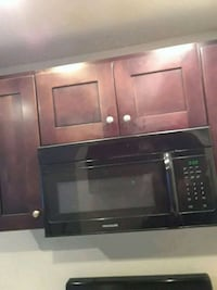 brown wooden TV hutch with flat screen television Los Angeles, 90044