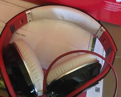 Red and white corded headphones beats
