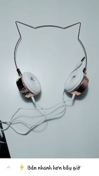 brown and white corded headphones