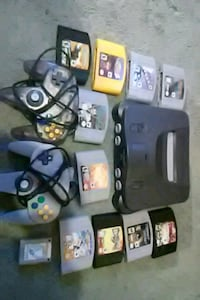 black Nintendo 64 console with controllers and gam