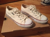 pair of white Fila low-top sneakers with box