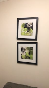 two black wooden framed paintings 41 km