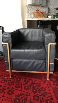 Black leather and brass armchair