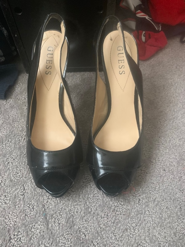 Pair of black leather peep toe heels guess brand worn maybe 4 or 5 times  7a15f5b0-1380-45dd-8f84-141ce6e88d07