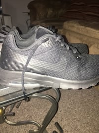 pair of gray Nike running shoes Winnipeg