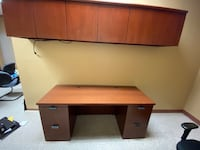 Desk and overhead Cabinet.
