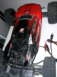 Remote control car 70mph plus remote charger 2 extra batteries