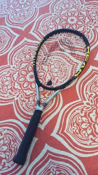 Blue and yellow Head tennis racket