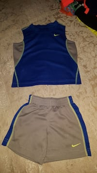 blue-and-gray Nike shorts and tank top