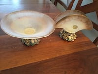 two white-and-brown ceramic napkin holder and decorative bowl