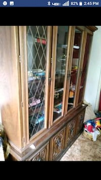 Solid wood antique china cabinet/hutch.