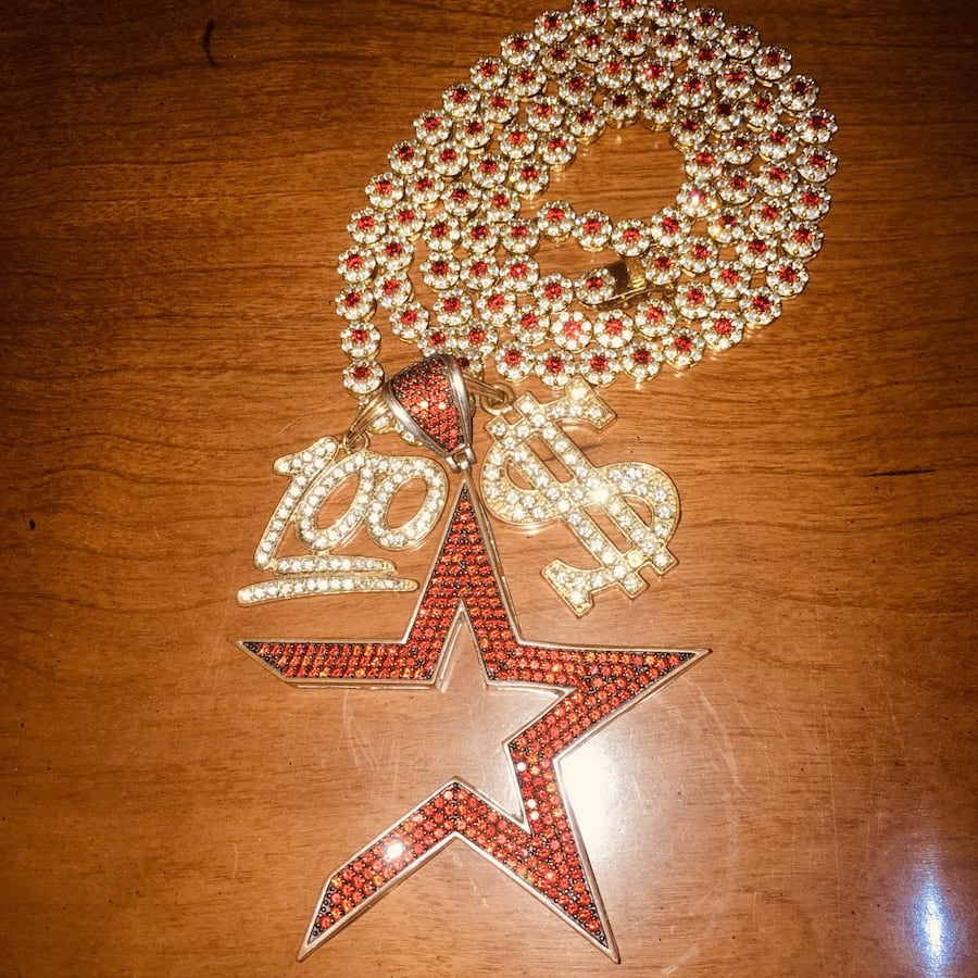 Iced out cosmic star and tennis chain real crystals in the chain. 7b71c792-d029-4468-8dd9-d915e6af4ed1