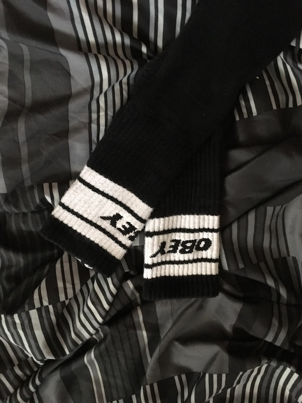 pair of black and white Obey socks