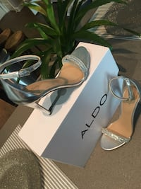 Pair of gray open-toe heeled sandals size 7.5 Columbia, 21045