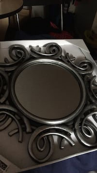 round mirror with gray metal frame