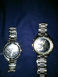 two round silver chronograph watches West Palm Beach