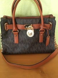 black and brown Michael Kors leather 2-way bag