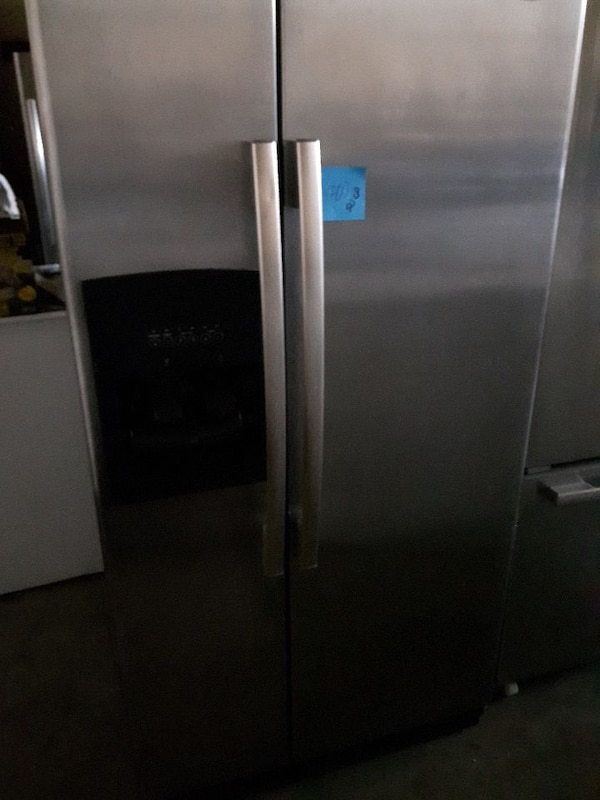 chrome steel side-by-side refrigerator with dispenser