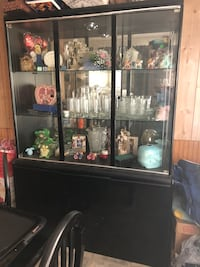 Black and Glass Hutch and table with 4 chairs Summerville