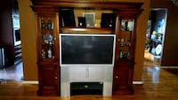 cherry wood entertainment center with television 40 inch television HD Parkville, 21234