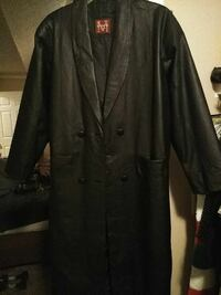 black double-breasted leather overcoat