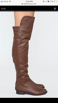unpaired brown leather knee-high boot Toronto, M4K 1P6