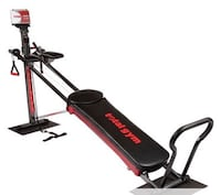 Black and red total gym exercise equipment