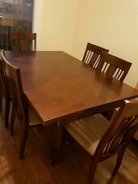 rectangular brown wooden table with four chairs dining set Mississauga, L5L