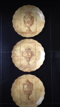 Three ceramic wall hanging plates
