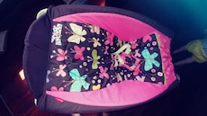 black and pink rocker and car seat