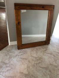 Brown wooden framed glass mirror Palm Bay, 32907