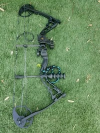 Black compound bow with case