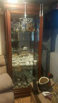 brown wooden framed glass display cabinet Bethpage, 11714