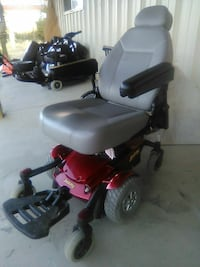 red and gray four wheeled mobility scooter