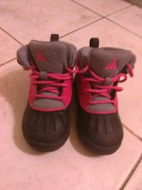 pair of black-and-pink Nike basketball shoes Houston, 77086