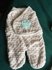 baby's white and teal owl print swaddle blanket